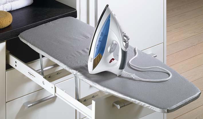Tabla de planchar en interior de cajón